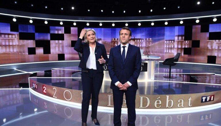 Makrons un Lepēna priekšvēlēšanu debatēs apmainās skarbiem apvainojumiem