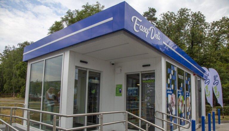 ФОТО: Компания Neste открыла первую в Латвии сеть магазинов без продавцов