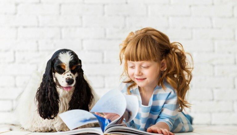 RCB aicina bērnus uzlabot lasītprasmi ar kanisterapijas palīdzību