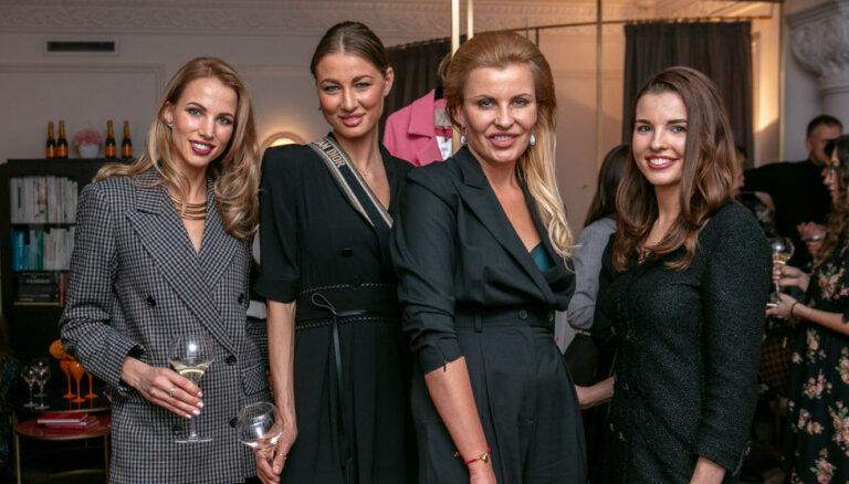 Foto: Modes butikā Rīgā aizvadīta izsmalcināta šampanieša ballīte
