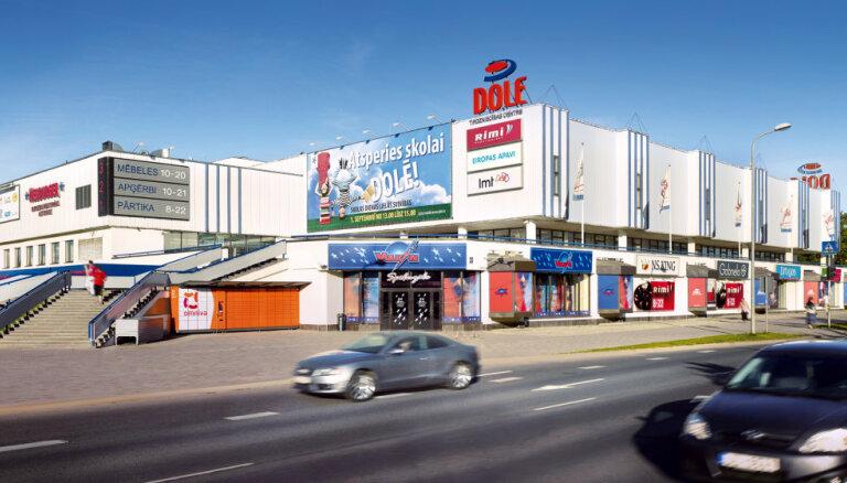 Владелец латвийских зданий McDonald's завершил сделку по покупке торгового центра в Риге