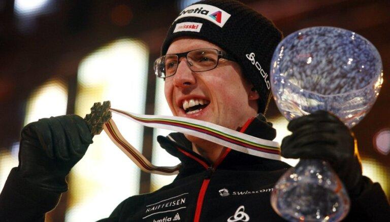 Olimpiskais čempions tramplīnlēkšanā Amans tomēr nebeigs sportista karjeru