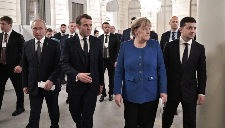 """Меркель заявила о необходимости адаптировать """"минские соглашения"""" под реалии"""