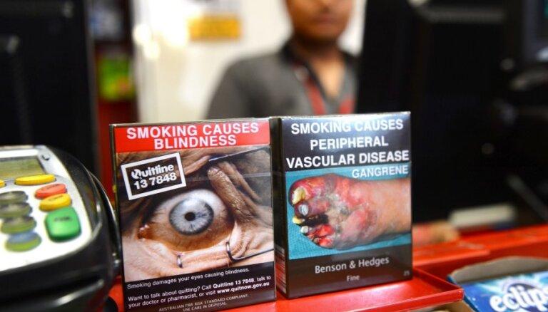 Сигареты предлагают продавать в пугающих одинаковых пачках (фото)